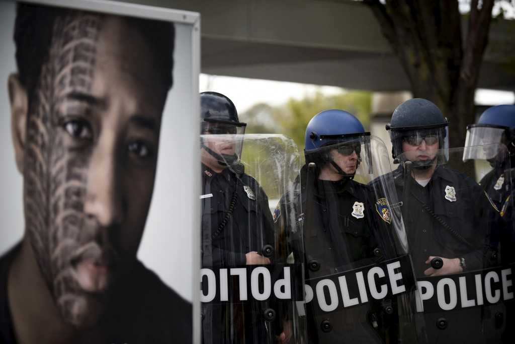 Police form a line during clashes with protesters near Mondawmin Mall after Freddie Gray's funeral in Baltimore April 27, 2015. Seven Baltimore police officers were injured on Monday as rioters threw bricks and stones and burned patrol cars in violent protests after the funeral of Gray, a black man who died in police custody. REUTERS/Sait Serkan Gurbuz - RTX1AJH9